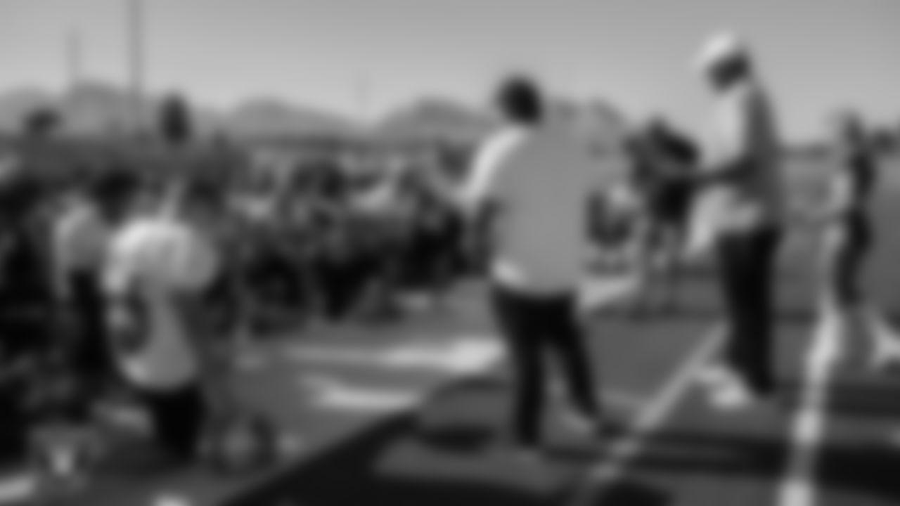 Las Vegas Raiders alumnus James Harris speaks to the Palo Verde High School football team before presenting their coach, Joe Aznarez, with the Tom Flores High School Coach of the Week award.