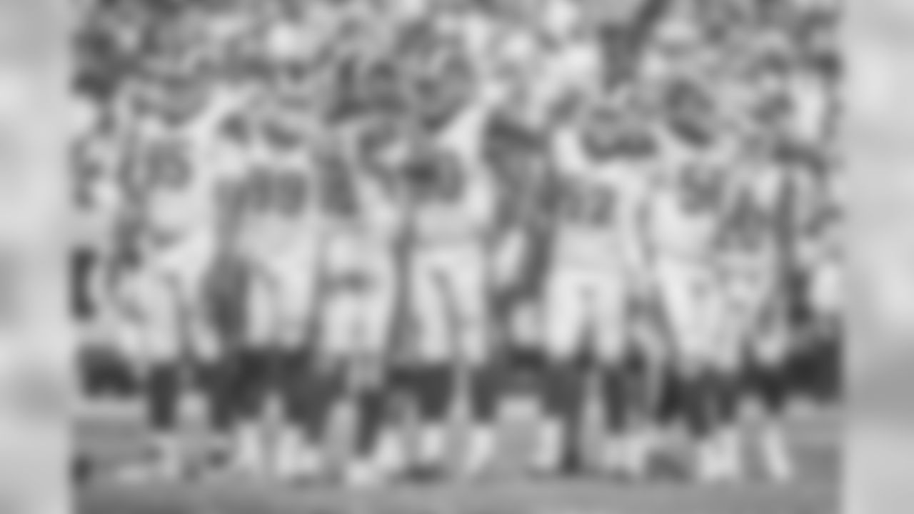 (95) Ethan Westbrooks, (99) Aaron Donald, (58) Cory Littleton, (90) Michael Brockers, (52) Ramik Wilson, (50) Samson Ebukam, and (20) Lamarcus Joyner of the Los Angeles Rams and the rest of the defense huddle and line up against the Arizona Cardinals during the Rams 34-0 victory over the Cardinals in an NFL Week 2 football game, Sunday, September 16, 2018, in Los Angeles, CA. (Jeff Lewis/Rams)