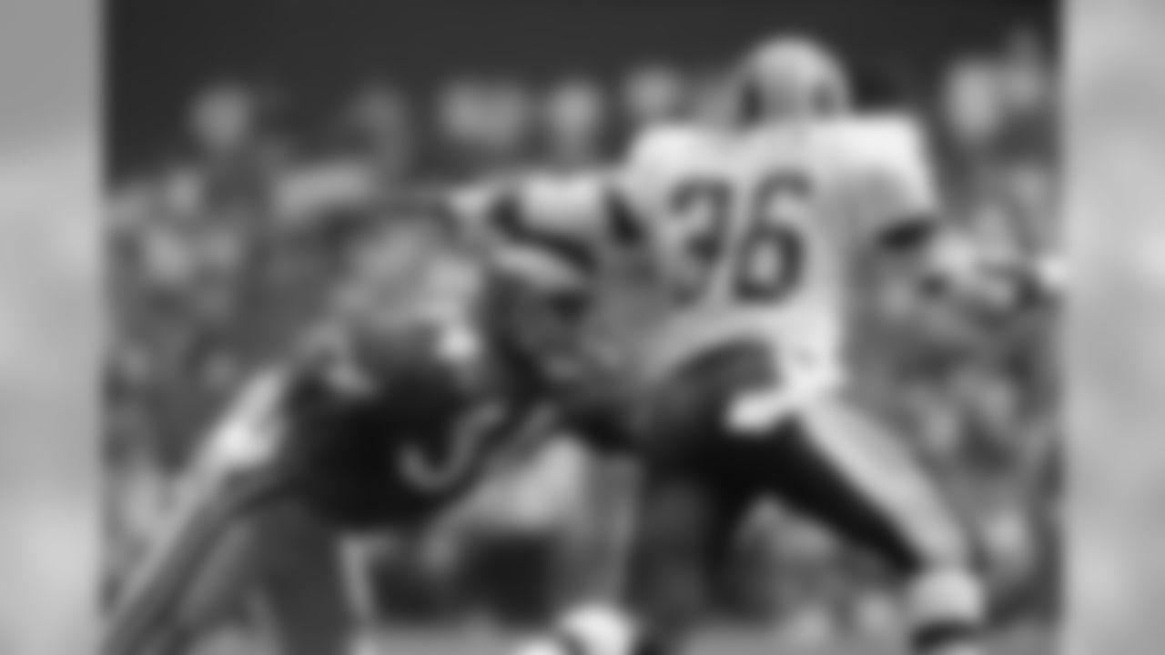 Washington running back Timmy Smith (36) tries for extra yardage as Philadelphia Eagles free safety Terry Hoage (34) tries to bring him down during second half action Sunday, September 19, 1988 at RFK Satadium in Washington, D.C. (AP Photo/J. Scott Applewhite)