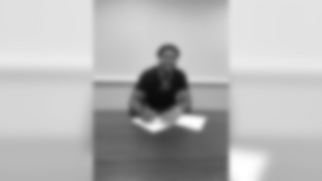 2020 first-round draft pick Chase Young signs his rookie contract with Washington on July 22, 2020.