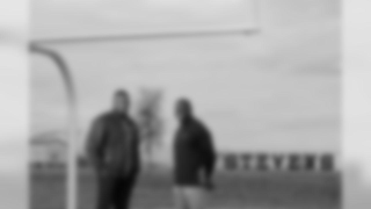 Portrait of Marcus Davenport's father Ron Davenport (left) with Marcus' high school football coach Darryl Hemphill, Wednesday Jan. 9, 2019, on the practice field at John Paul Stevens High School.  (Photo By Edward A. Ornelas)