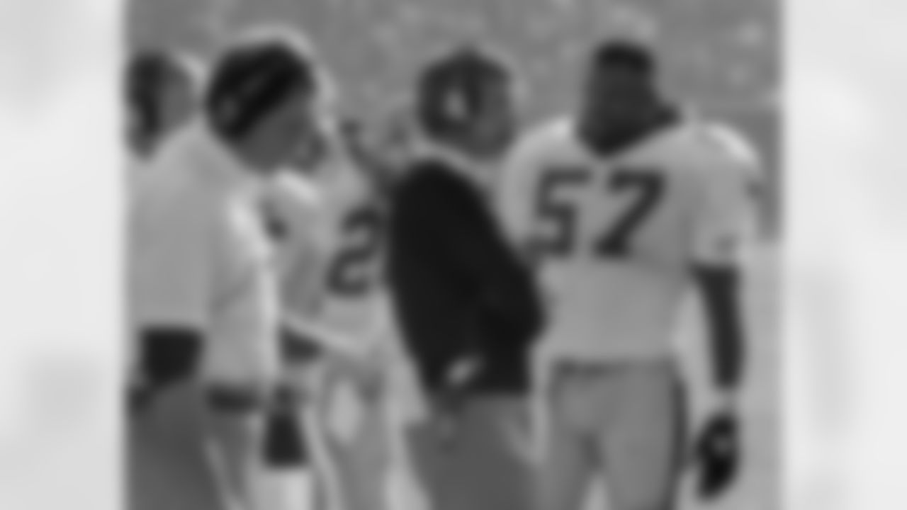 San Francisco 49ers vs New Orleans Saints at Candlestick Park Sunday, December 11, 1988.  49ers beat Saints 30-17.  Saints Head Coach Jim Mora talks to linebacker Rickey Jackson (57).  (AP Photo/Al Golub)