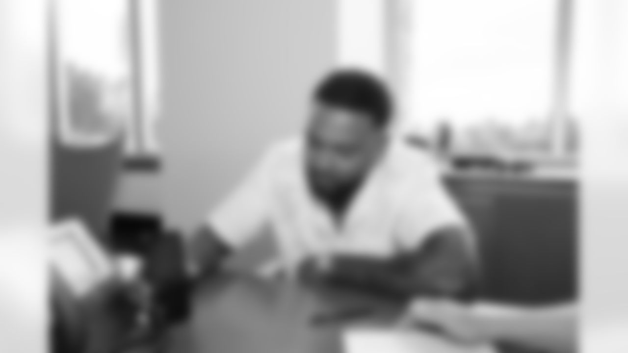 Jamal Adams signs his contract extension with the Seattle Seahawks on August 17, 2021.