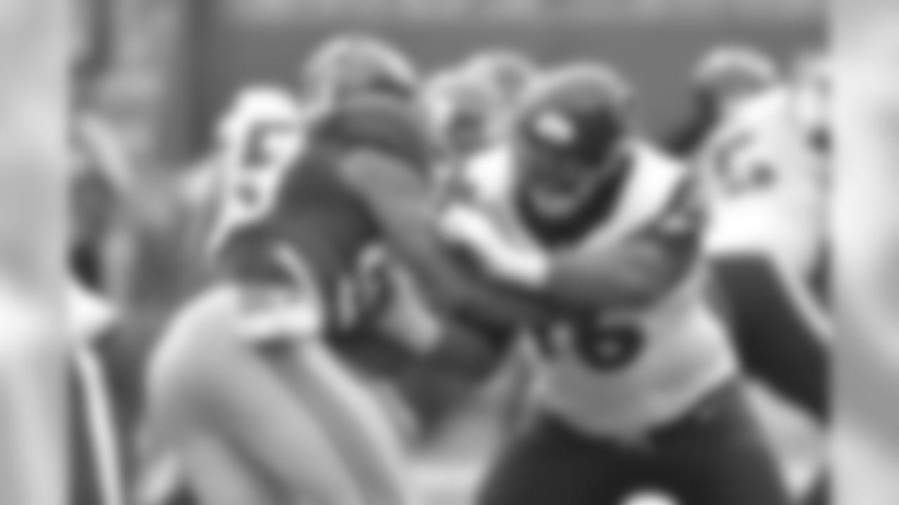 Houston Texans offensive lineman Duane Brown (76) blocks against Damontr'e Moore (98) during a NFL week 3 regular season football game against the New York Giants on Sunday, Sept. 21, 2014 in East Rutherford, N.J. The Giants won the game 30-17. (AP Photo/Matt Patterson)