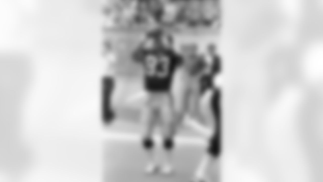 Action photograph of wide receiver Louis Lipps #83 during his time with the Steelers.