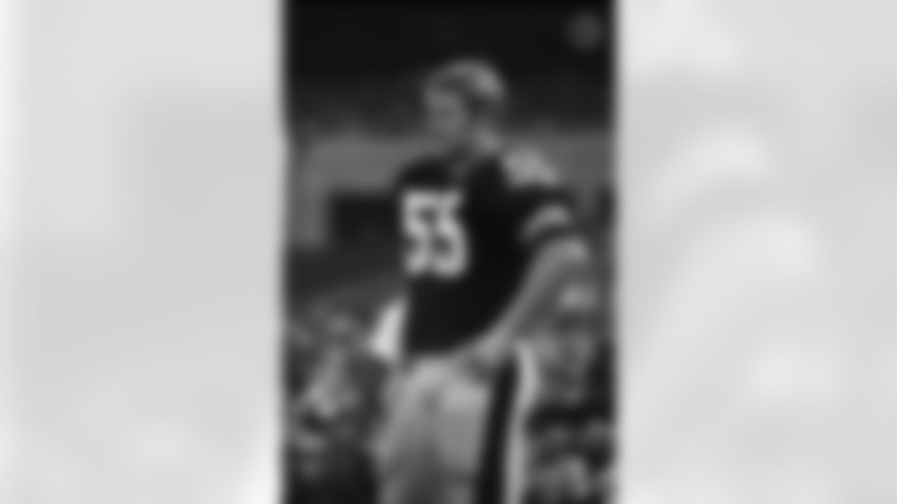 Action photograph of offensive lineman Jon Kolb #55 during his time with the Steelers.