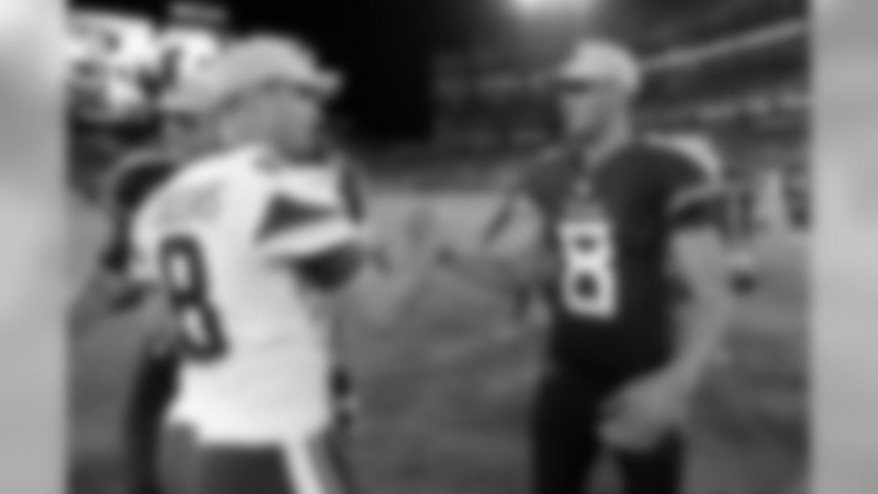 Minnesota Vikings quarterback Kirk Cousins, left, shakes hands with Tennessee Titans quarterback Marcus Mariota, right, after a preseason NFL football game Thursday, Aug. 30, 2018, in Nashville, Tenn. The Vikings won 13-3. (AP Photo/Mark Zaleski)