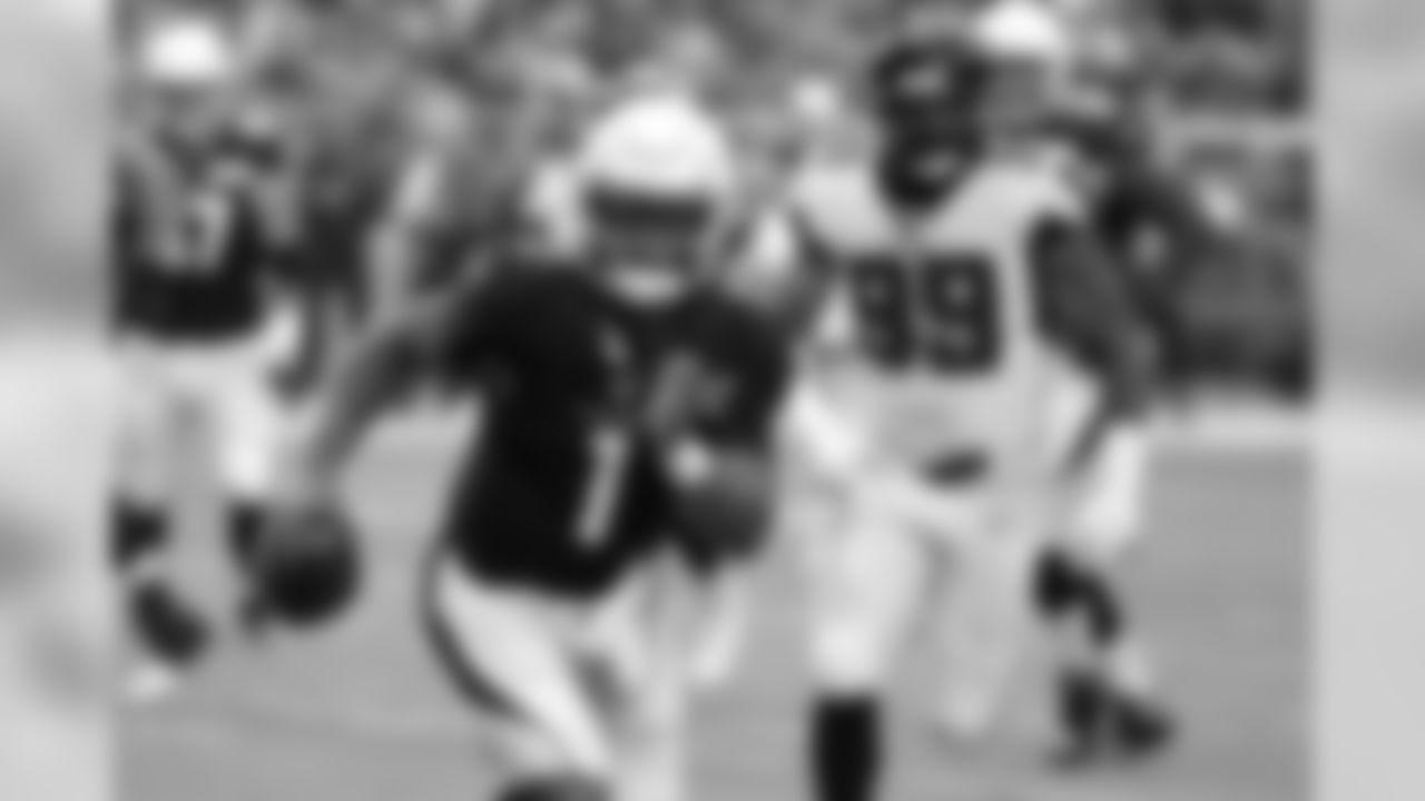 Cardinals quarterback Kyler Murray (1) scrambles as Falcons defensive end Adrian Clayborn (99) pursues.