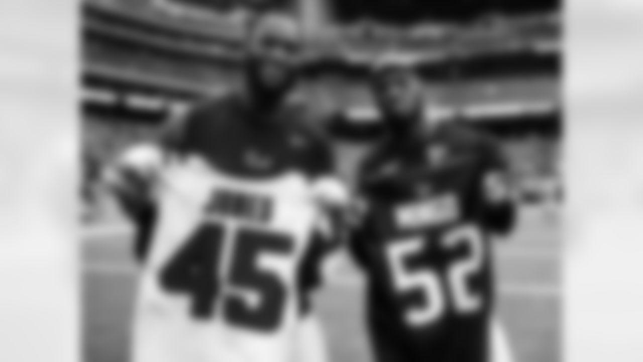 Atlanta Falcons linebacker Deion Jones #45 with Houston Texans outside linebacker Barkevious Mingo #52 at NRG Stadium in Houston, Texas, on Sunday October 6, 2019. (Photo by Kara Durrette/Atlanta Falcons)