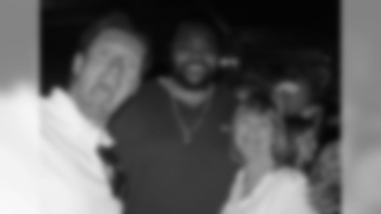Nancy Gilbertson at a fundraiser with Brian and former Vikings right tackle Phil Loadholt