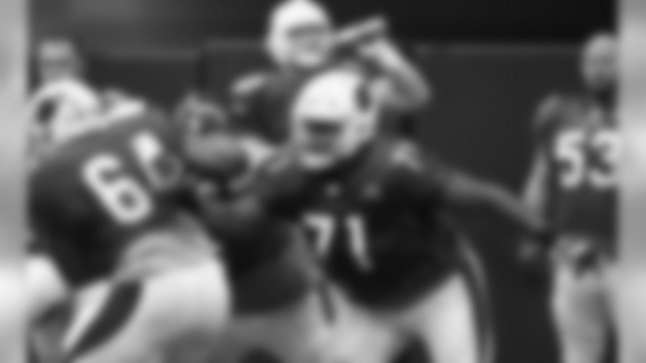 Arizona Cardinals' Kaleb Johnson (71) puts a block on Dorian Johnson (64) during an NFL football training camp Saturday, July 29, 2017, in Glendale, Ariz. (AP Photo/Ross D. Franklin)