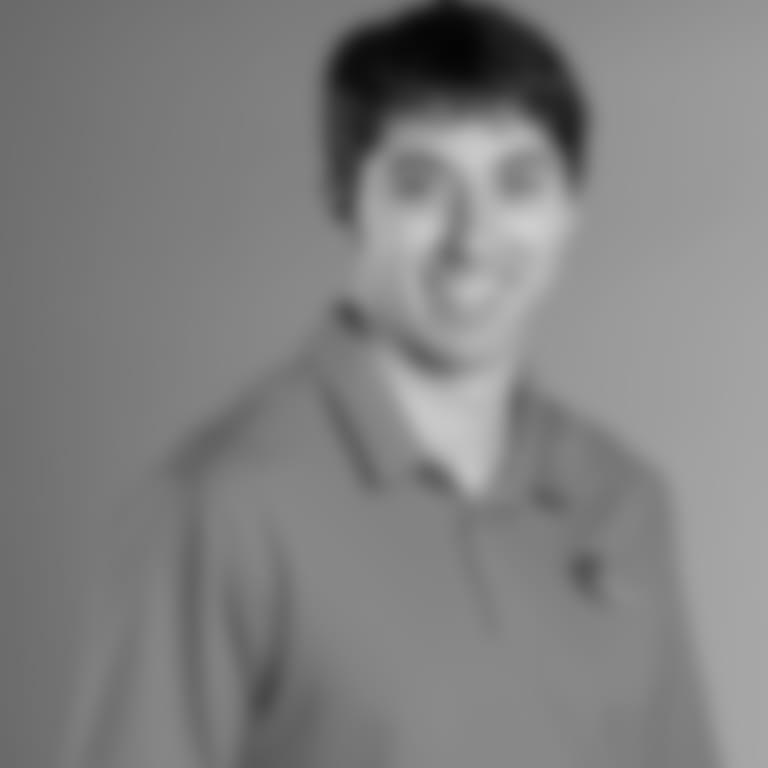 Headshot picture of Miles McQuinn