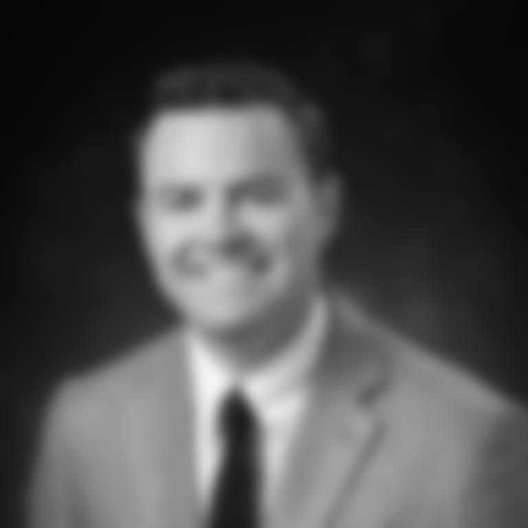 Headshot picture of Drew Dougherty