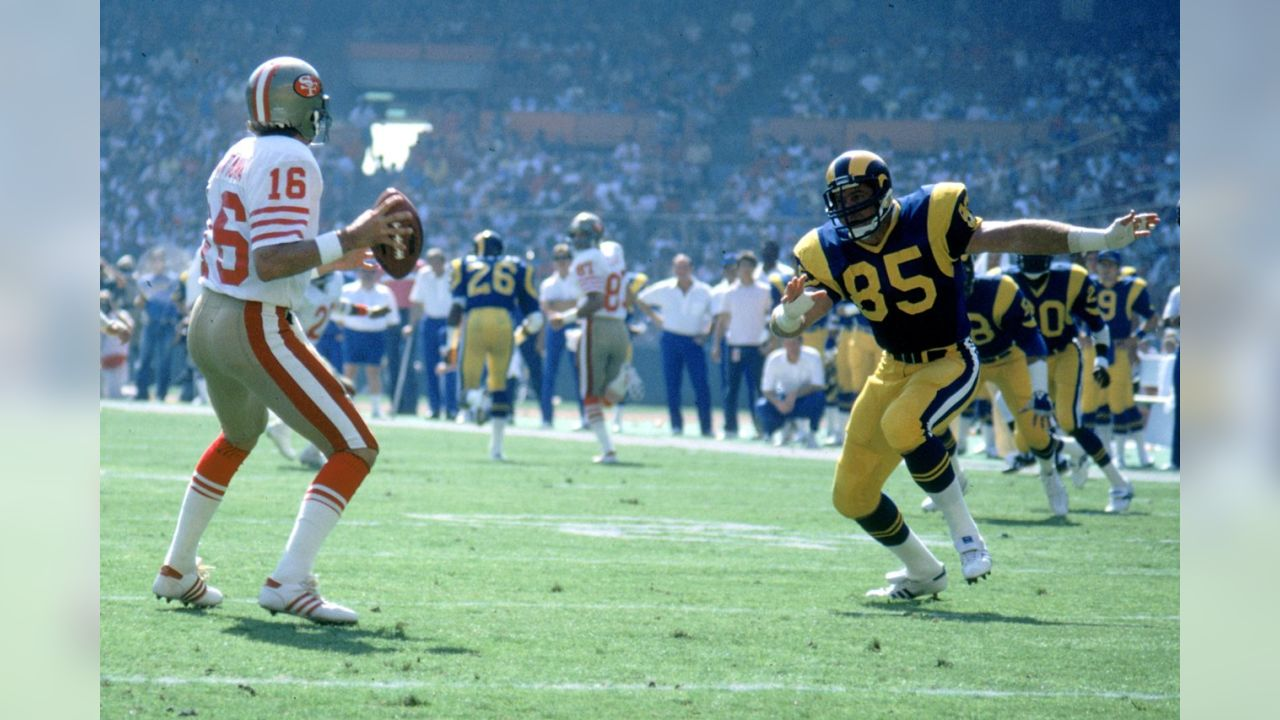 Oct. 23, 1983 -- Rams pass-rusher Jack Youngblood and 49ers quarterback Joe Montana.