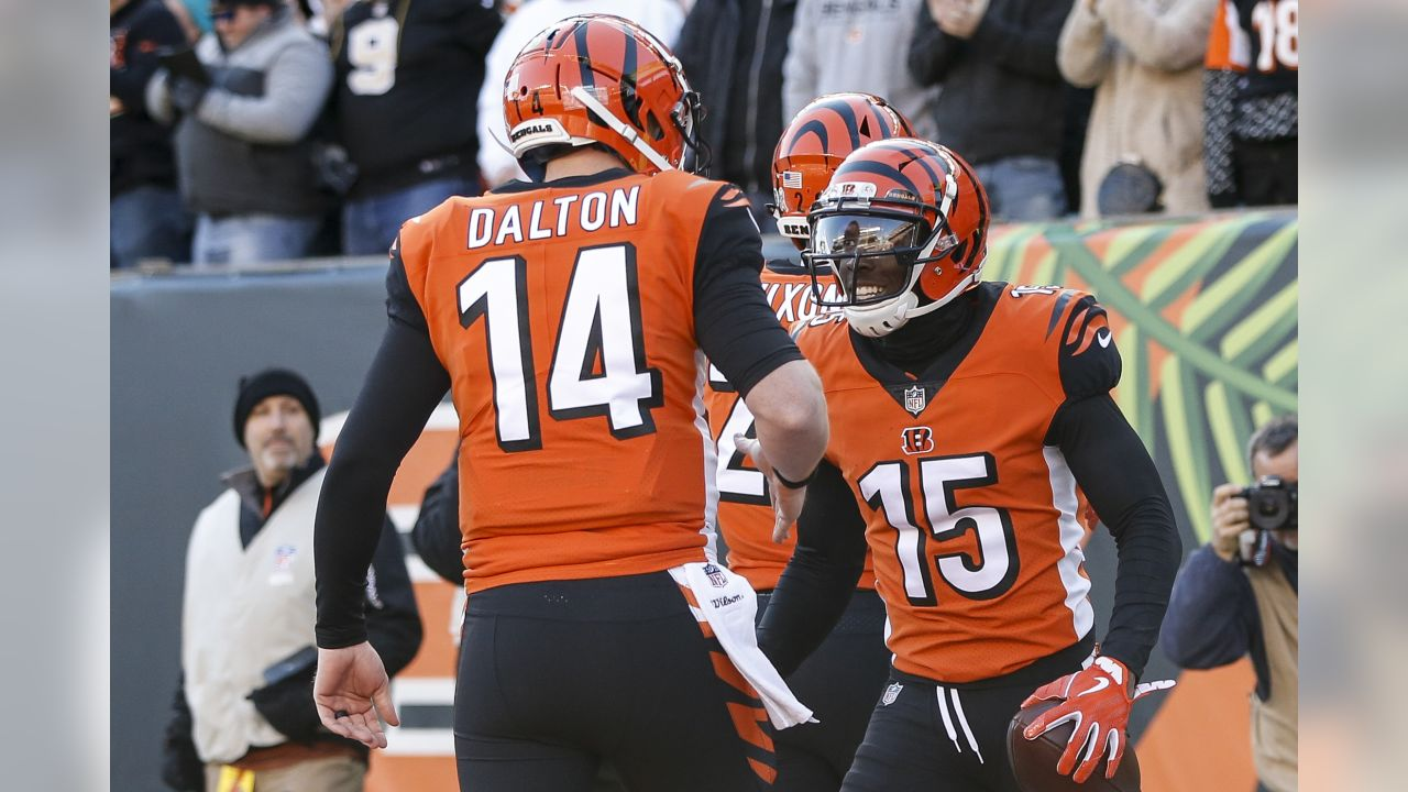 Cincinnati Bengals wide receiver John Ross (15) celebrates his touchdown with quarterback Andy Dalton (14) in the first half of an NFL football game against the New Orleans Saints, Sunday, Nov. 11, 2018, in Cincinnati. (AP Photo/Frank Victores)