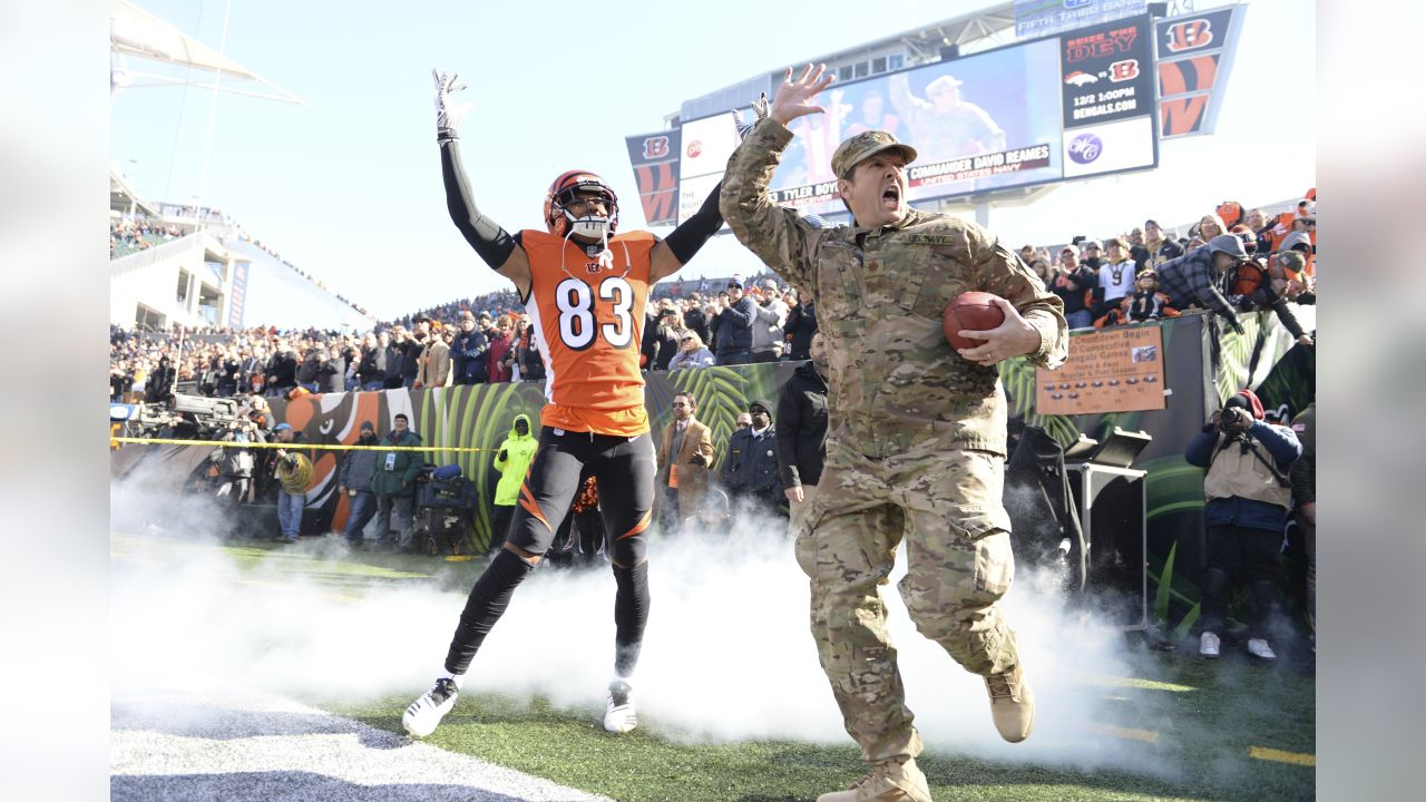 Cincinnati Bengals wide receiver Tyler Boyd (83) takes the field with a member of the armed forces before an NFL football game against the New Orleans Saints, Sunday, Nov. 11, 2018, in Cincinnati. (NFL Photos via AP)