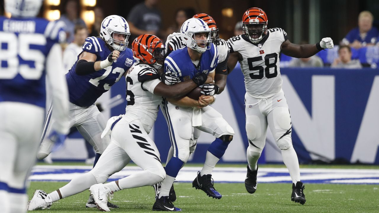 Cincinnati Bengals defensive end Carlos Dunlap (96) strips the back from Indianapolis Colts quarterback Andrew Luck (12) during the second half of an NFL football game in Indianapolis, Sunday, Sept. 9, 2018. (AP Photo/Jeff Roberson)