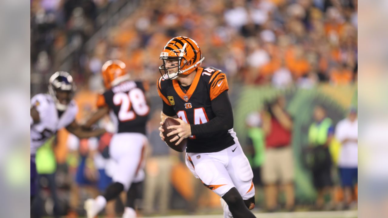 Quarterback Andy Dalton rolls out to the left in a Thursday night game against the Baltimore Ravens.