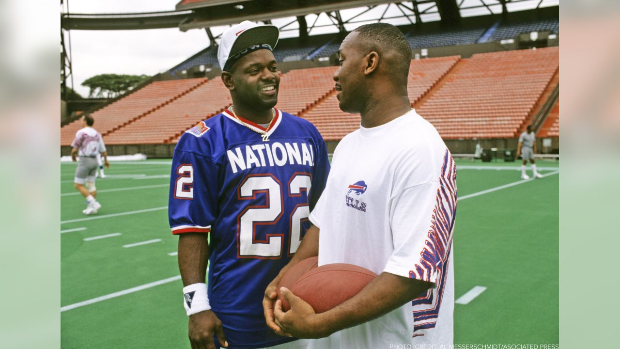 Running back Thurman Thomas (right) talking to fellow running back Emmitt Smith at the 1992 Pro Bowl. Linebacker Cornelius Bennett, quarterback Jim Kelly, wide receiver James Lofton, wide receiver Andre Reed, guard Jim Ritcher, linebacker Darryl Talley and wide receiver Steve Tasker were also named to the 1992 Pro Bowl.