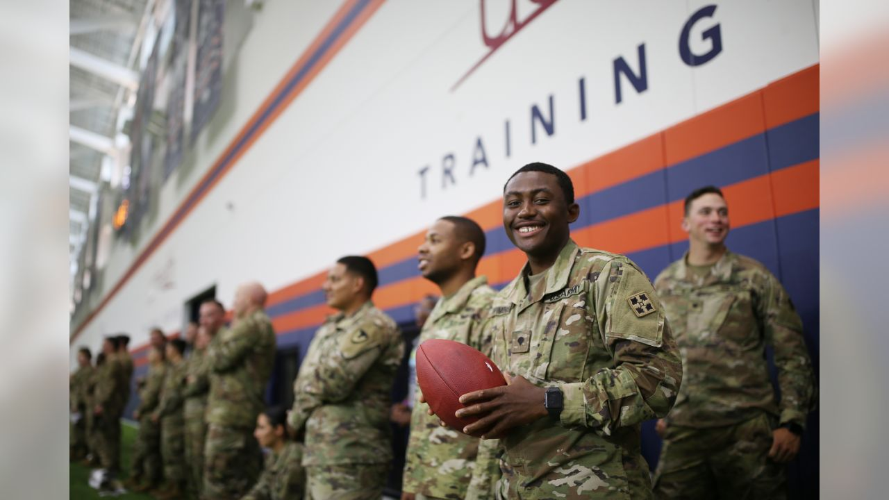 Military members visit and view practice as part of a USAA luncheon on June 4, 2019.