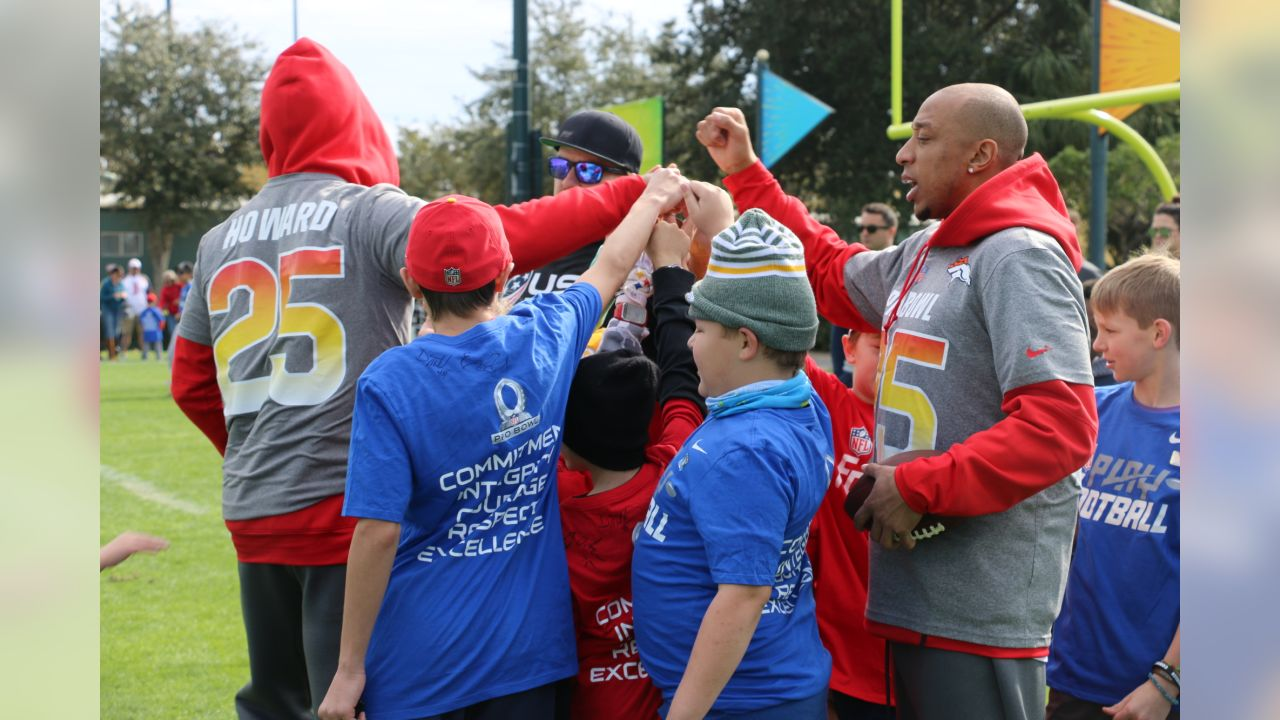 Chris Harris Jr. takes part in Play Football clinics with Fuel Up to PLAY 60 students with other Pro Bowl players on January 26, 2019, at ESPN Wide World of Sports.