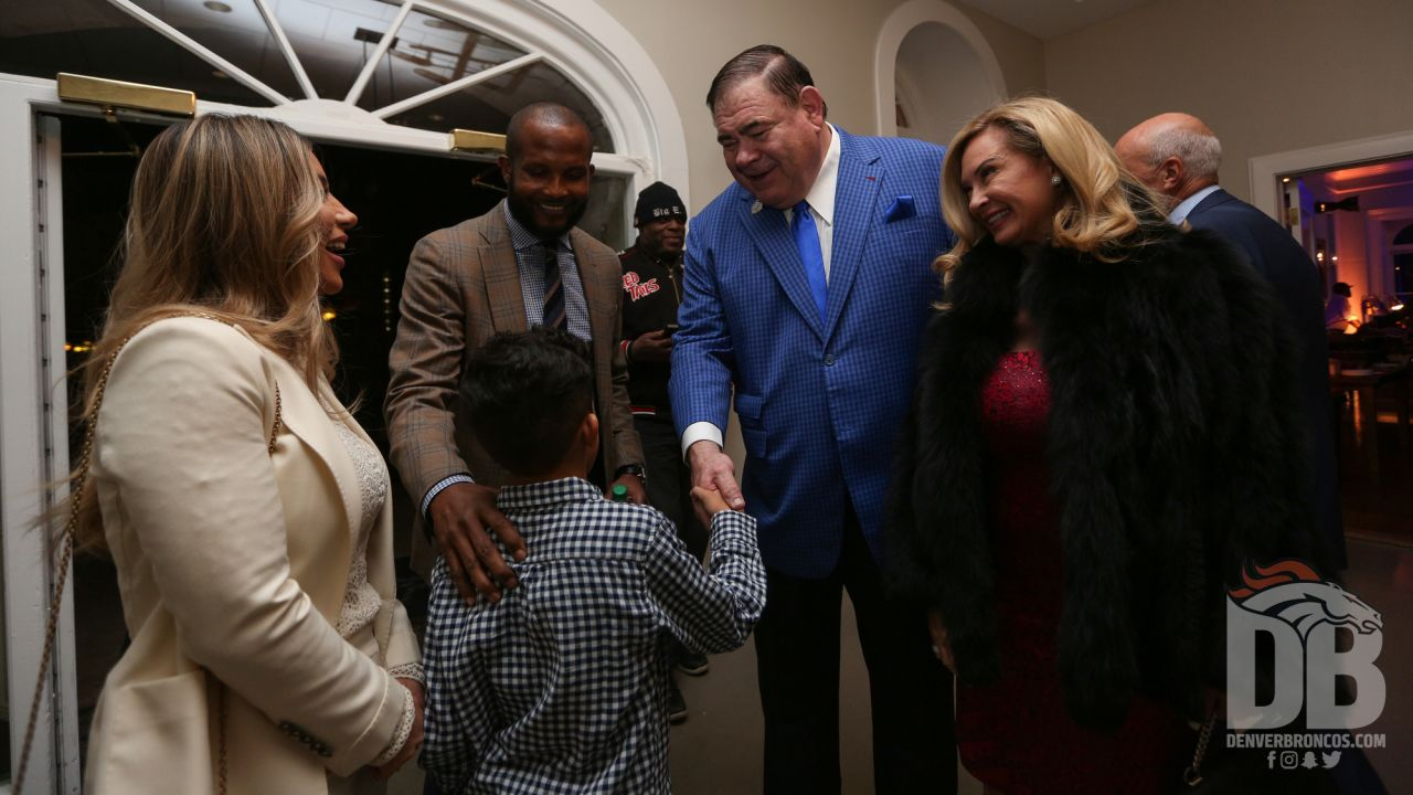 President of the Pro Football Hall of Fame David Baker greets Champ Bailey and his family at the Pro Football Hall of Fame's Celebration of Excellence Reception in Atlanta on January 31, 2019.