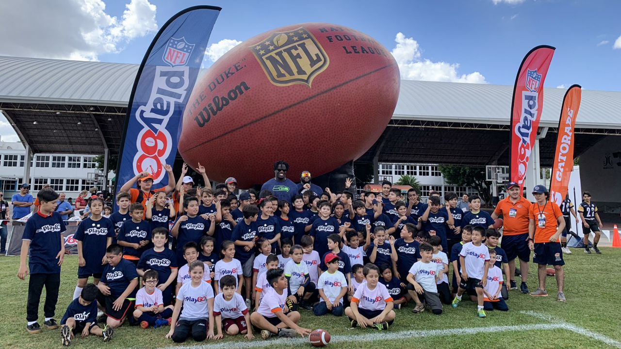Zach Kerr takes a group photo at the Tochito National Tournament on February 9, 2019, as a player ambassador for the flag football tournament.