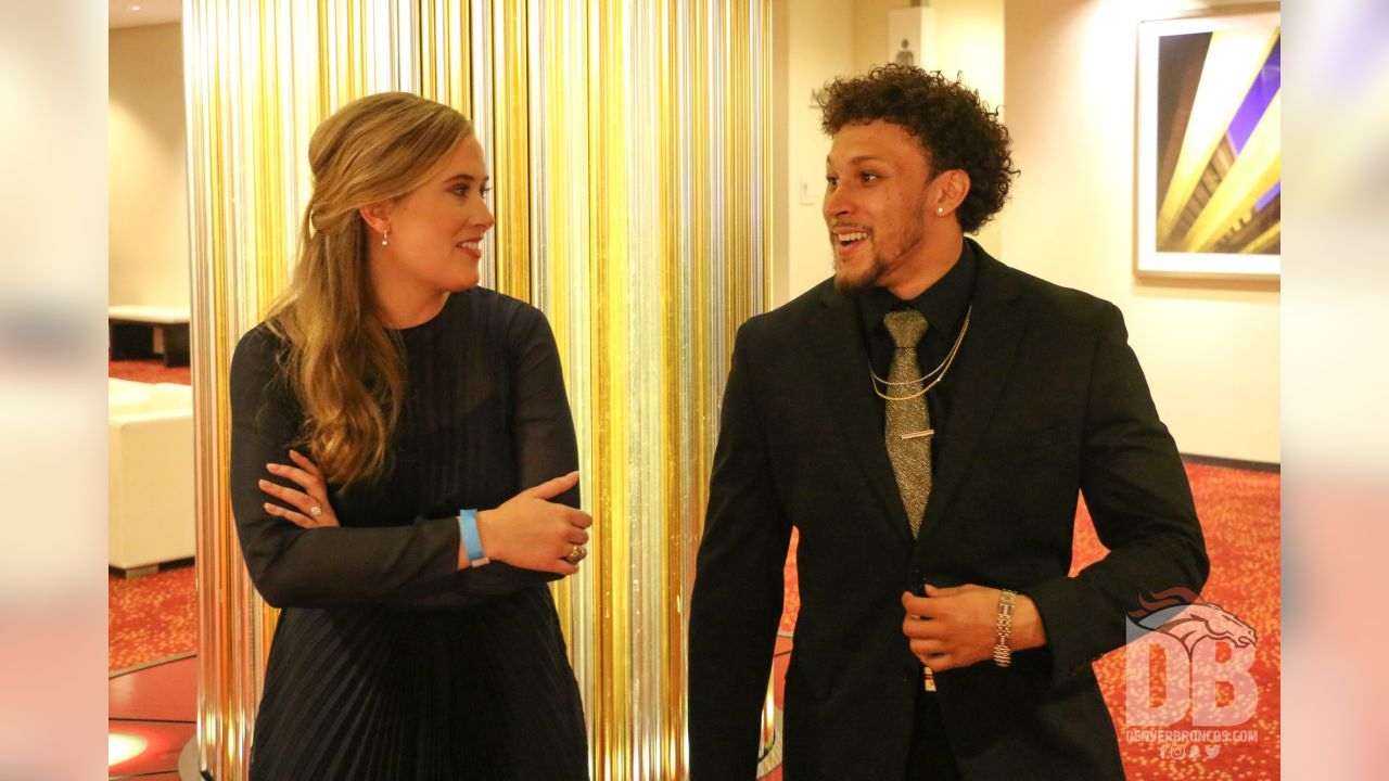 Brittany Bowlen greets Phillip Lindsay before awaiting the knock on the door announcing the Pro Football Hall of Fame's selection of Pat Bowlen for enshrinement in the Class of 2019 on February 2, 2019.