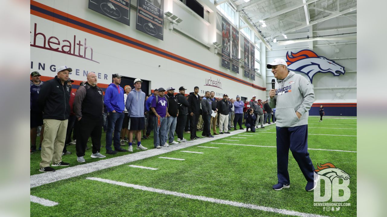 Vic Fangio talks with high school football coaches during organized team activities at UCHealth Training Center in Centennial, CO, May 20, 2019.