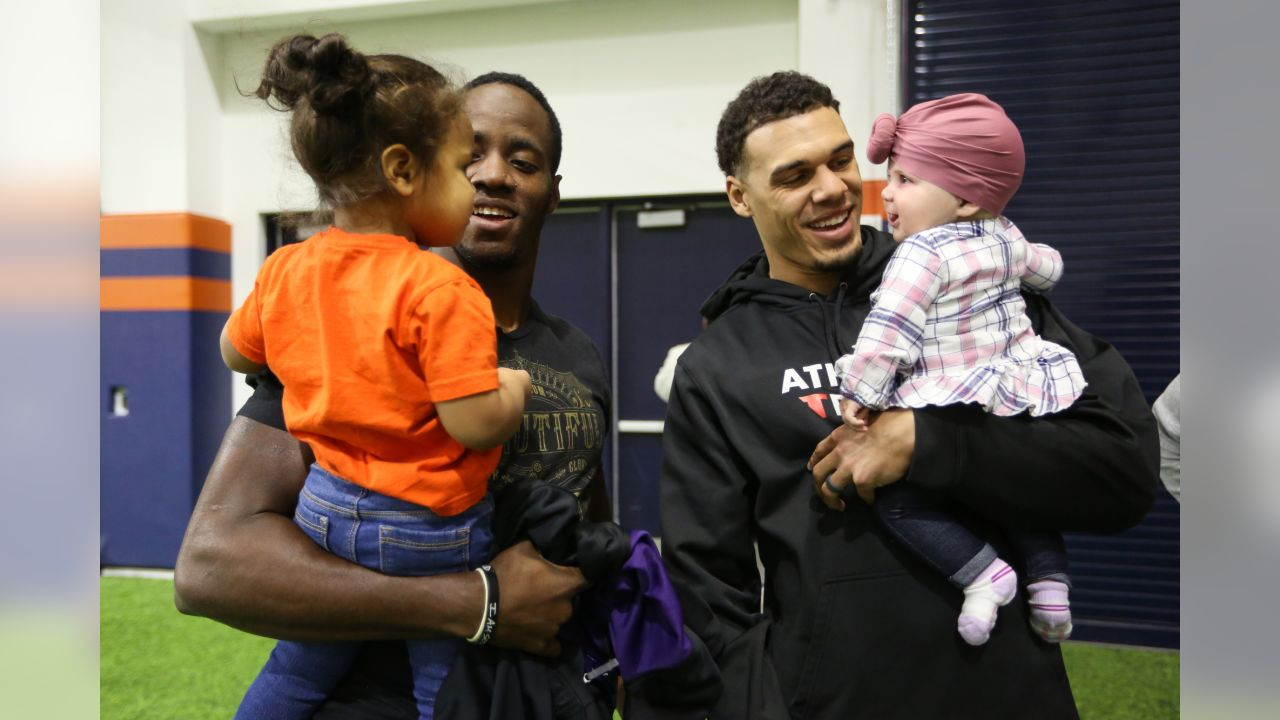 Joe Jones and his daughter Scarlette with Justin Simmons and his daughter Laney during a Salute to Service-themed PLAY 60 clinic for children from military families in the Pat Bowlen Fieldhouse at UCHealth Training Center on November 13, 2018.