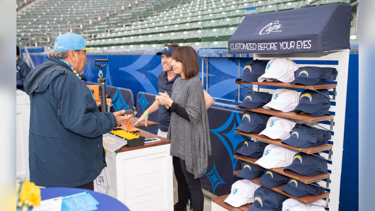 Custom-making a Chargers hat on the field during Conversation with Playmakers at ROKiT Field at Dignity Health Sports Park on Thursday, June 6, 2019 in Carson, CA.