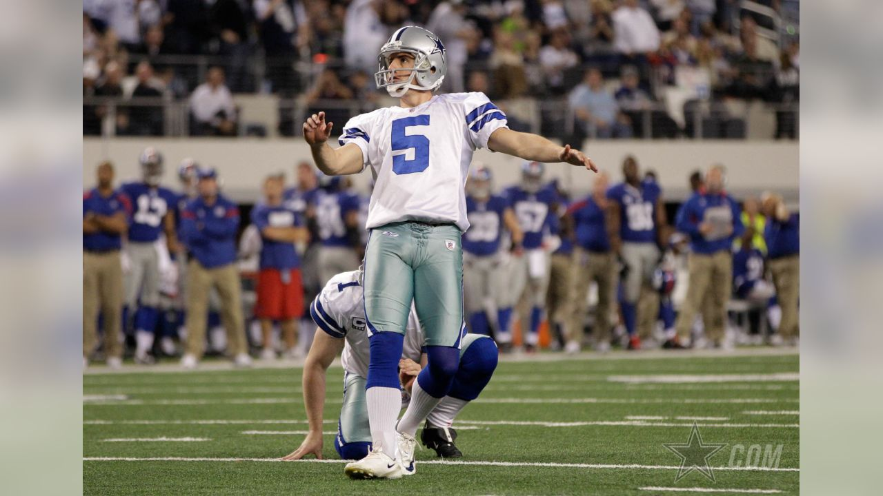 Dallas Cowboys kicker Dan Bailey (5) looks on at a field goal attempt as punter Mat McBriar (1) holds during an NFL football game against the New York Giants Sunday, Dec. 11, 2011, in Arlington, Texas. The Giants won 37-34. (AP Photo/Tony Gutierrez)