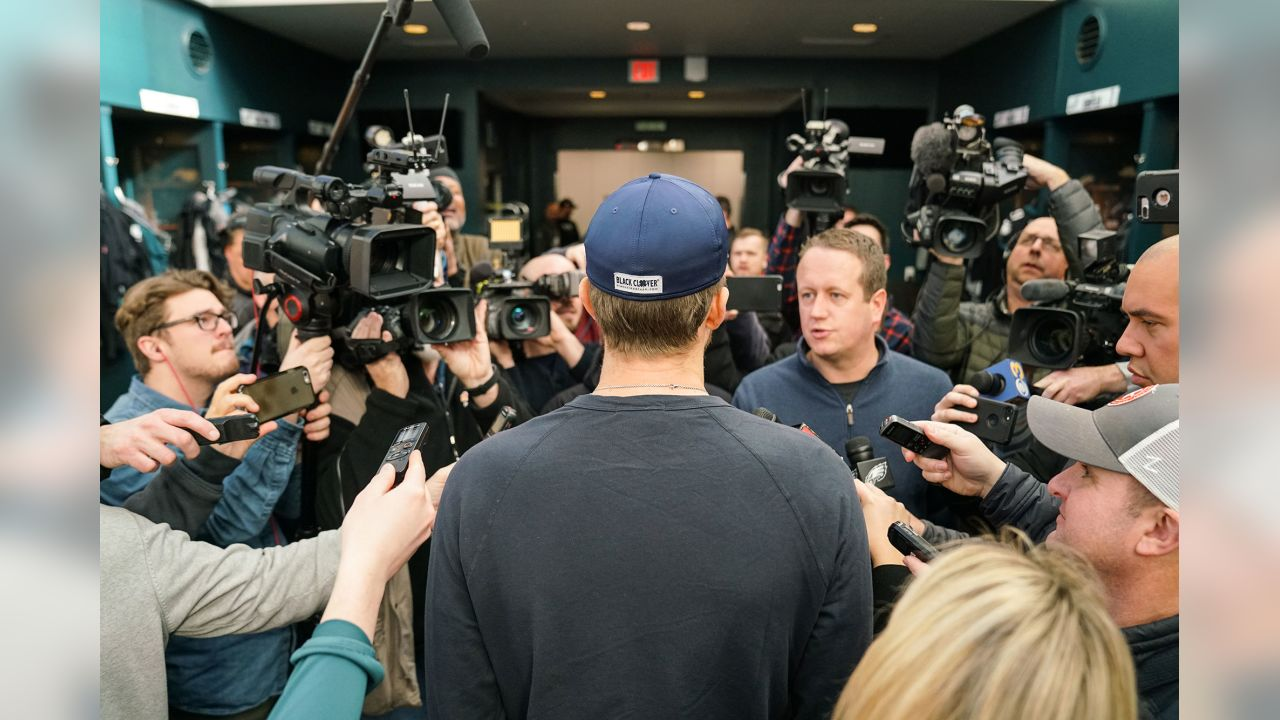 QB Nick Foles surrounded by media