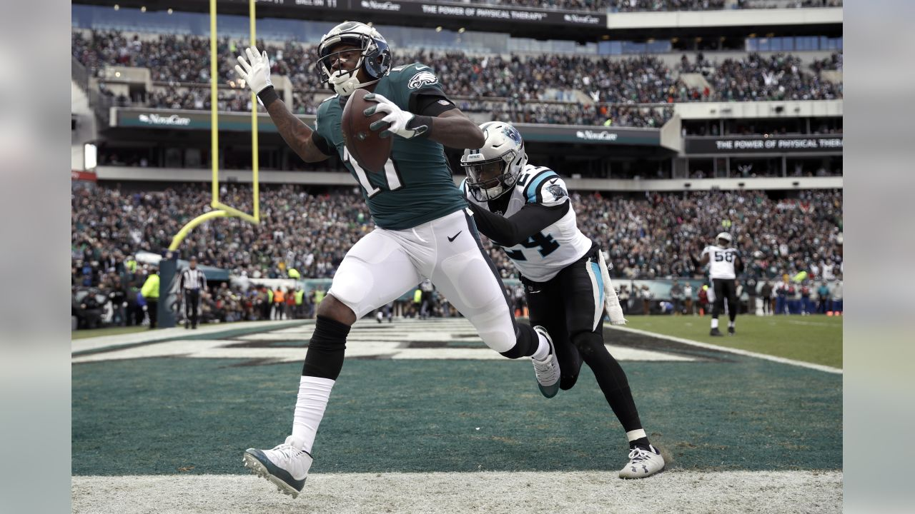 Philadelphia Eagles wide receiver Alshon Jeffery (17) is pushed by Carolina Panthers cornerback James Bradberry (24) after catching a touchdown pass from quarterback Carson Wentz, not pictured, during the first half of an NFL football game, Sunday, Oct. 21, 2018, in Philadelphia. (AP Photo/Matt Rourke)
