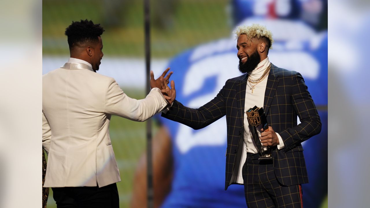 Odell Beckham Jr. of the New York Giants, right, presents the award for offensive rookie of the year to Saquon Barkley of the New York Giants at the 8th Annual NFL Honors at The Fox Theatre on Saturday, Feb. 2, 2019, in Atlanta. (Photo by Paul Abell/Invision for NFL/AP Images)