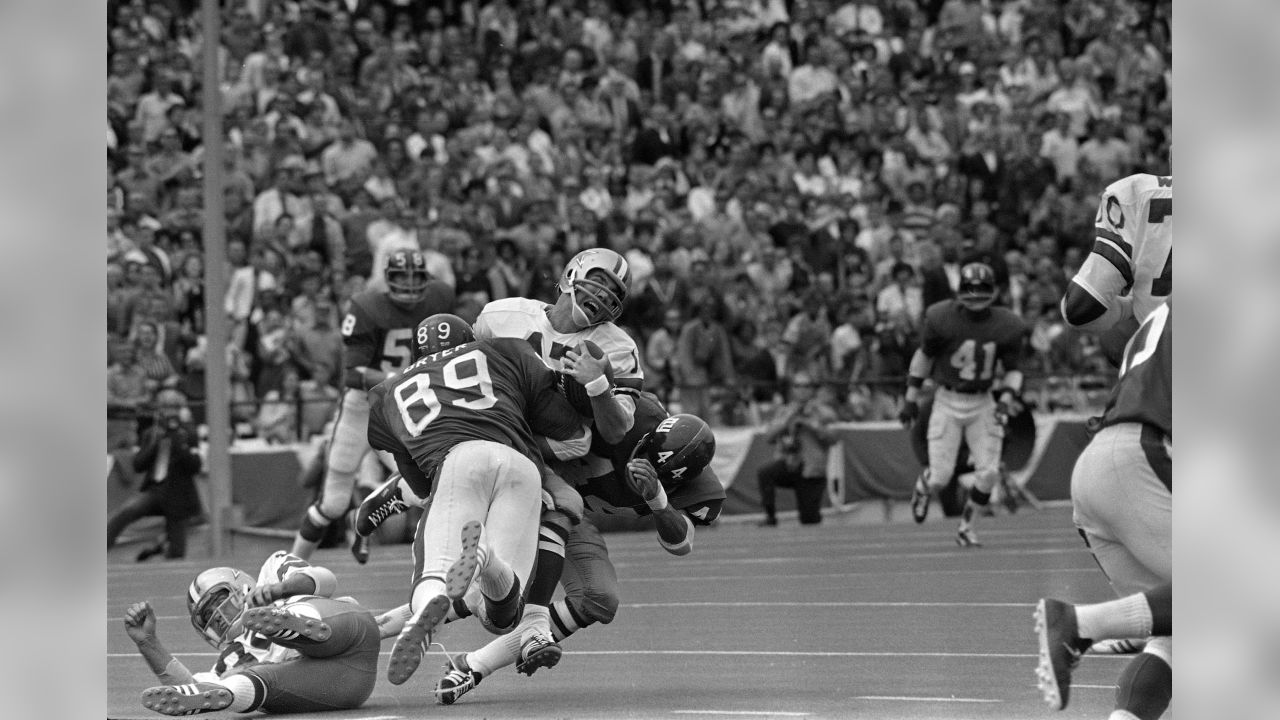Dallas Cowboys quarterback Roger Staubach (12) grimaces as he is hit hard  by New 30dabf73e