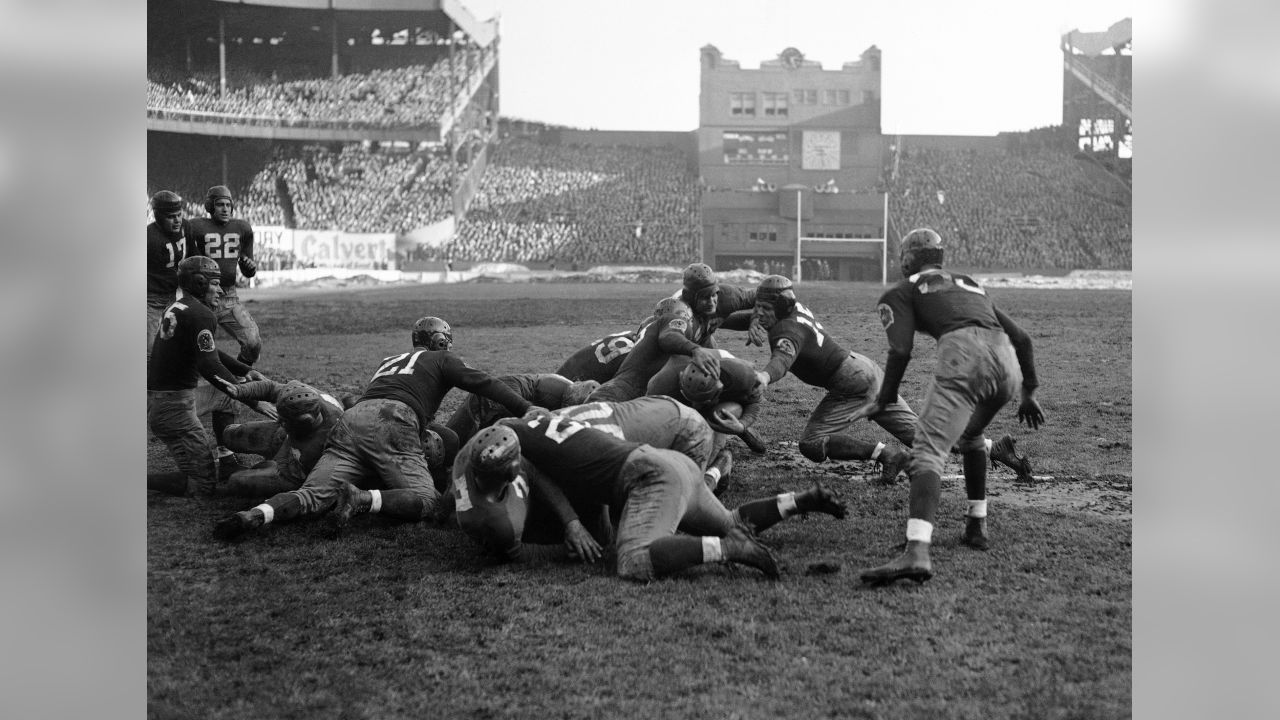 New York Giants fullback John Karcis plunges to score from the one foot line against the Washington Redskins at the Polo Grounds in New York City, Dec. 4, 1938. A crowd of 57,461 saw the Giants win, 36-0, to take the Eastern Division title. (AP Photo)