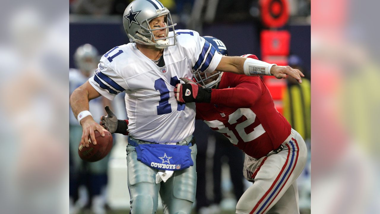 Dallas Cowboys quarterback Drew Beldsoe is sacked by New York Giants left  end Michael Strahan in 20289434e