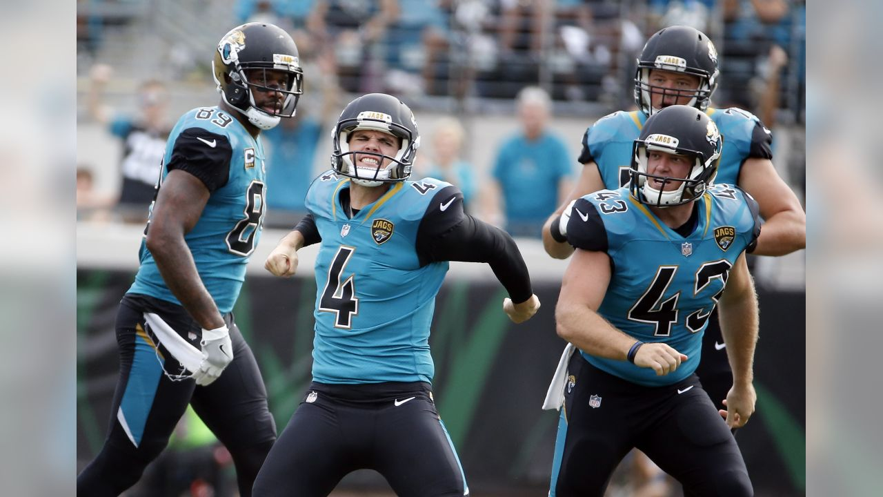 Jacksonville Jaguars kicker Josh Lambo (4) celebrates after making a 56-yard field goal against the Cincinnati Bengals as teammates tight end Marcedes Lewis (89) and long snapper Matt Overton (43) look on during the first half of an NFL football game, Sunday, Nov. 5, 2017, in Jacksonville, Fla. (AP Photo/Stephen B. Morton)