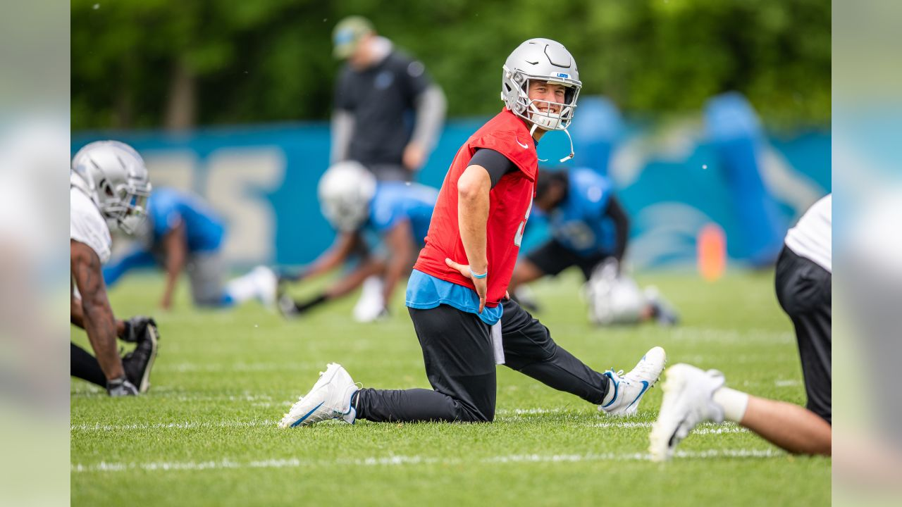 Detroit Lions quarterback Matthew Stafford (9) smiles during stretching before Day 1 of minicamp on Tuesday, June 4, 2019 in Allen Park, Mich. (Detroit Lions via AP)