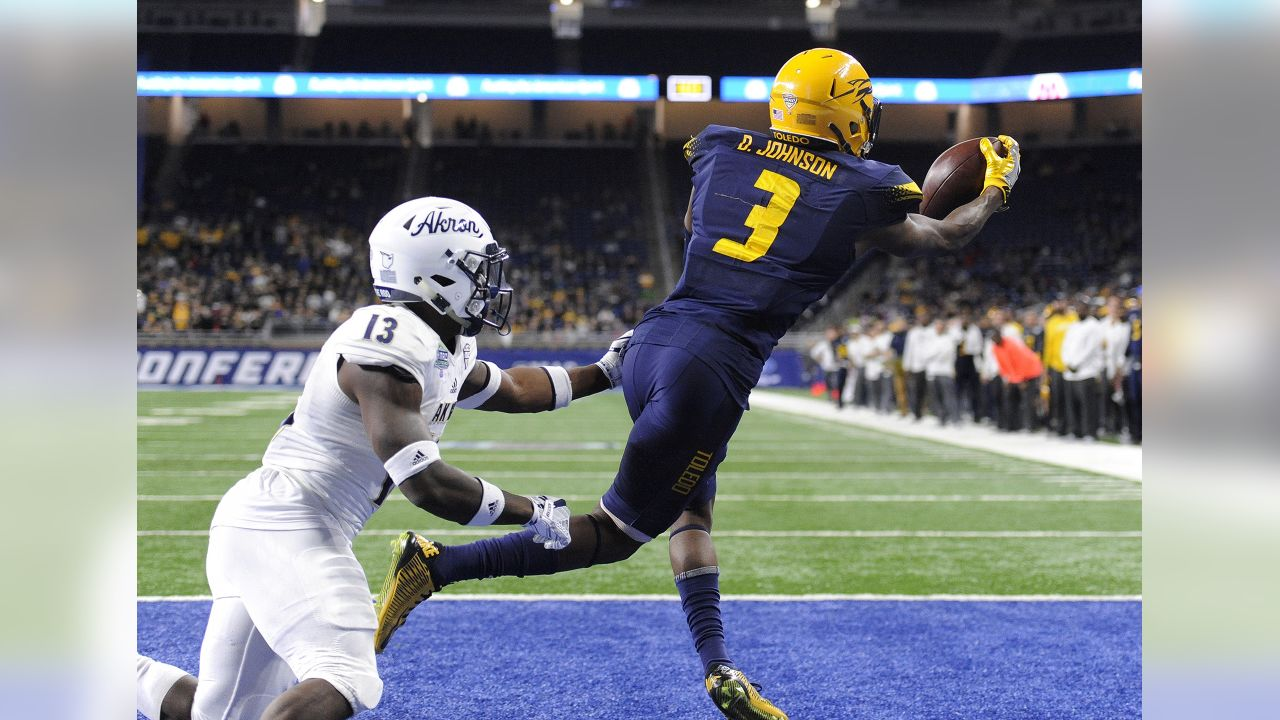 Toledo wide receiver Diontae Johnson (3) catches the ball for a touchdown past Akron defensive back Denzel Butler (13) during the second quarter of the Mid-American Conference championship NCAA college football game, Saturday, Dec. 2, 2017, in Detroit. Toledo retained possession of the ball. (AP Photo/Jose Juarez)
