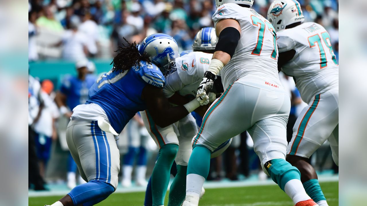 Detroit Lions defensive tackle Ricky Jean Francois (97) sacks Miami Dolphins quarterback Brock Osweiler (8) during a NFL football game against the Miami Dolphins on Sunday, Oct. 21, 2018 in Miami Gardens, Fla. (Detroit Lions via AP).