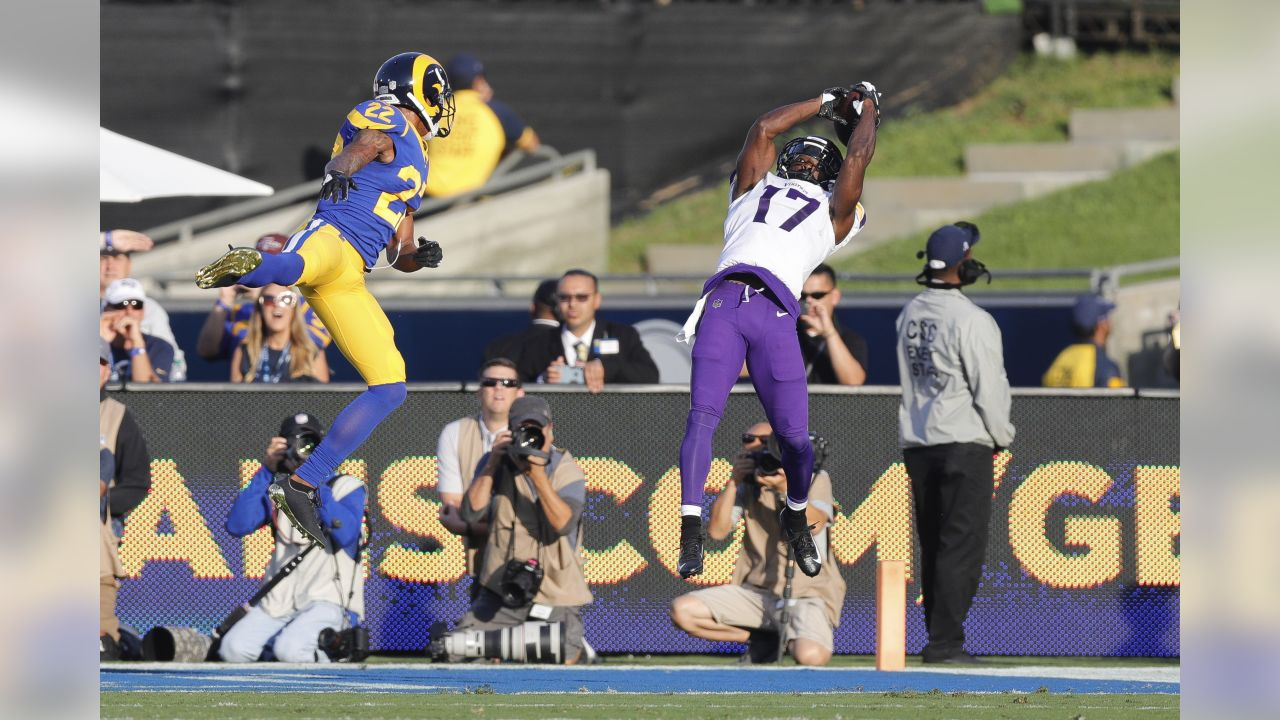 Minnesota Vikings wide receiver Aldrick Robinson (17) catches the ball for a touchdown in front of Los Angeles Rams cornerback Marcus Peters (22) during an NFL football game on Thursday, Sept. 27, 2018 in Los Angeles. Robinson catches the ball for a touchdown. Los Angeles won 38-31. (Peter Read Miller via AP)