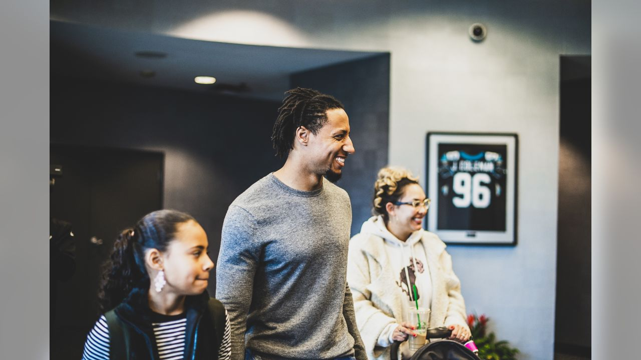 Eric Reid and family at Bank of America Stadium on Monday, Feb. 11, 2019 after signing a three-year contract extension.