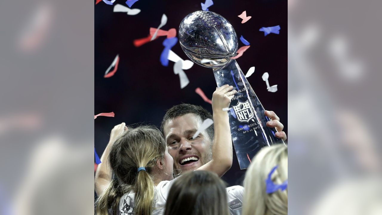 Atlanta: New England Patriots' Tom Brady holds the trophy and his daughter, Vivian, after the NFL Super Bowl 53 football game against the Los Angeles Rams, Sunday, Feb. 3, 2019, in Atlanta. The Patriots won 13-3. AP/PTI Photo(AP2_4_2019_000008A)