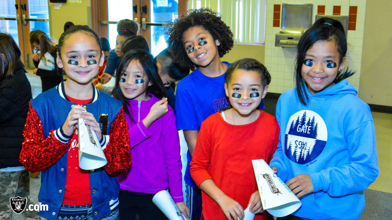 Local teacher Ada Feliciano of Forbuss Elementary School wins two tickets to Super Bowl LIII for her excellent work with the Fuel Up to Play 60 program, on Thursday, January 31, 2019, in Las Vegas, Nev. The Raiders showed their support by gifting Feliciano with new luggage to accompany her on her trip.