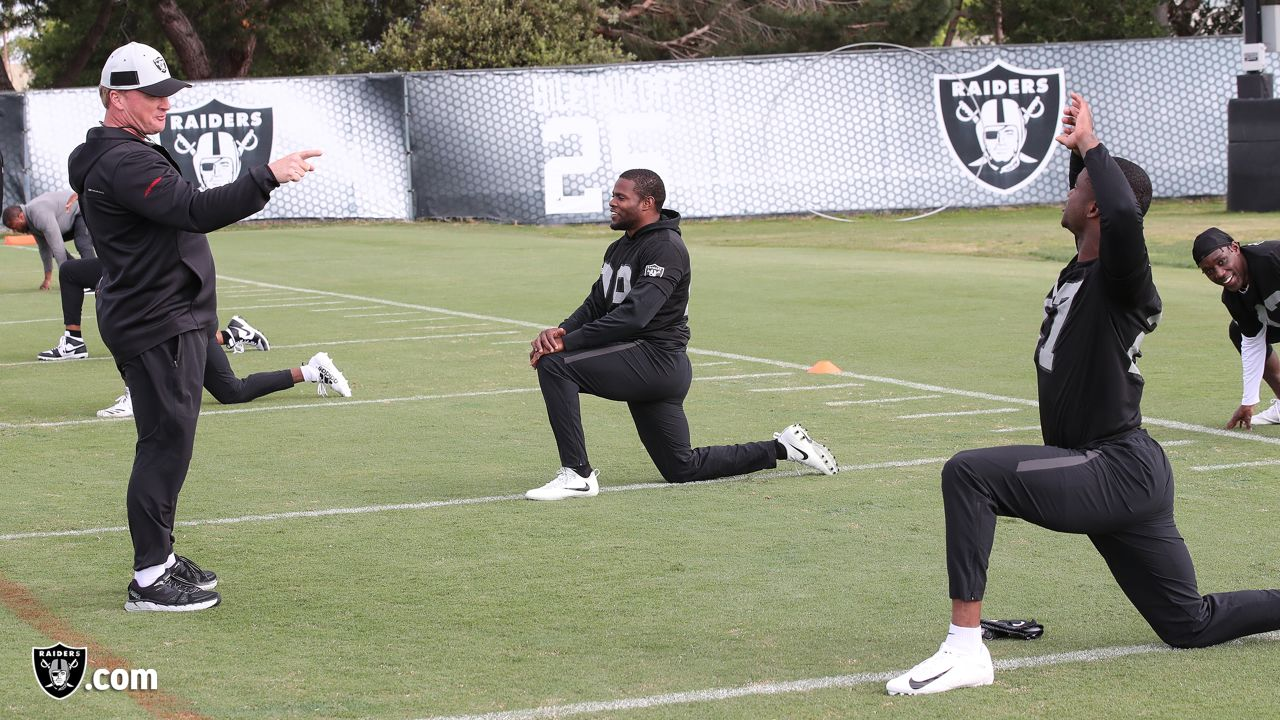 Raiders head coach Jon Gruden, safety Lamarcus Joyner (29), and cornerback Trayvon Mullen (27) at a workout during phase two of the offseason program at the Raiders Practice Facility in Alameda, Calif.