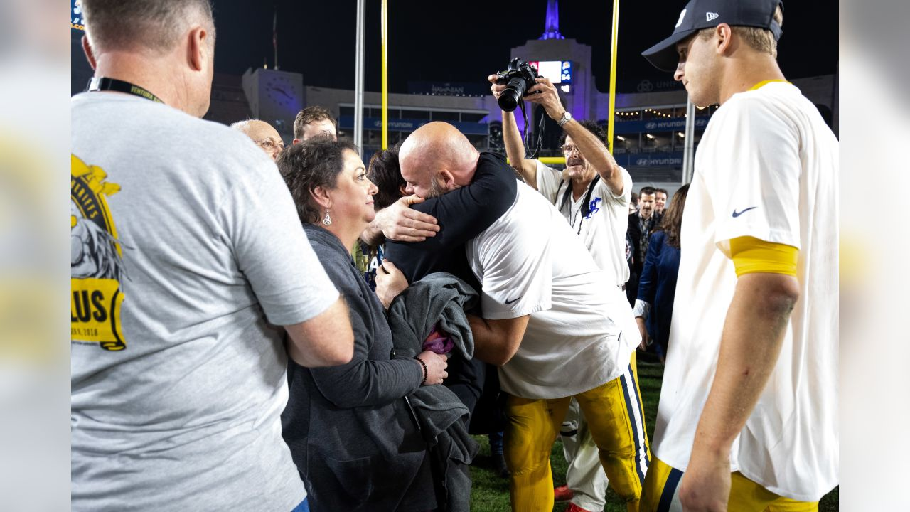 Los Angeles Rams offensive tackle Andrew Whitworth (77) meets families impacted by the Borderline tragedy following an NFL football game against the Kansas City Chiefs, Monday, Nov. 19, 2018, in Los Angeles. (Hiro Ueno/Rams)