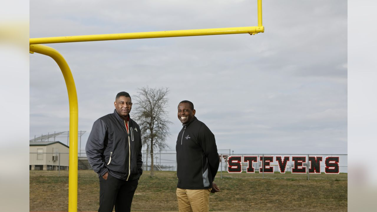 Portrait of Marcus Davenport's father Ron Davenport (left) with Marcus' high school football coach Darryl Hemphill, Wednesday Jan. 9, 2019, on the practice field at John Paul Stevens High School.