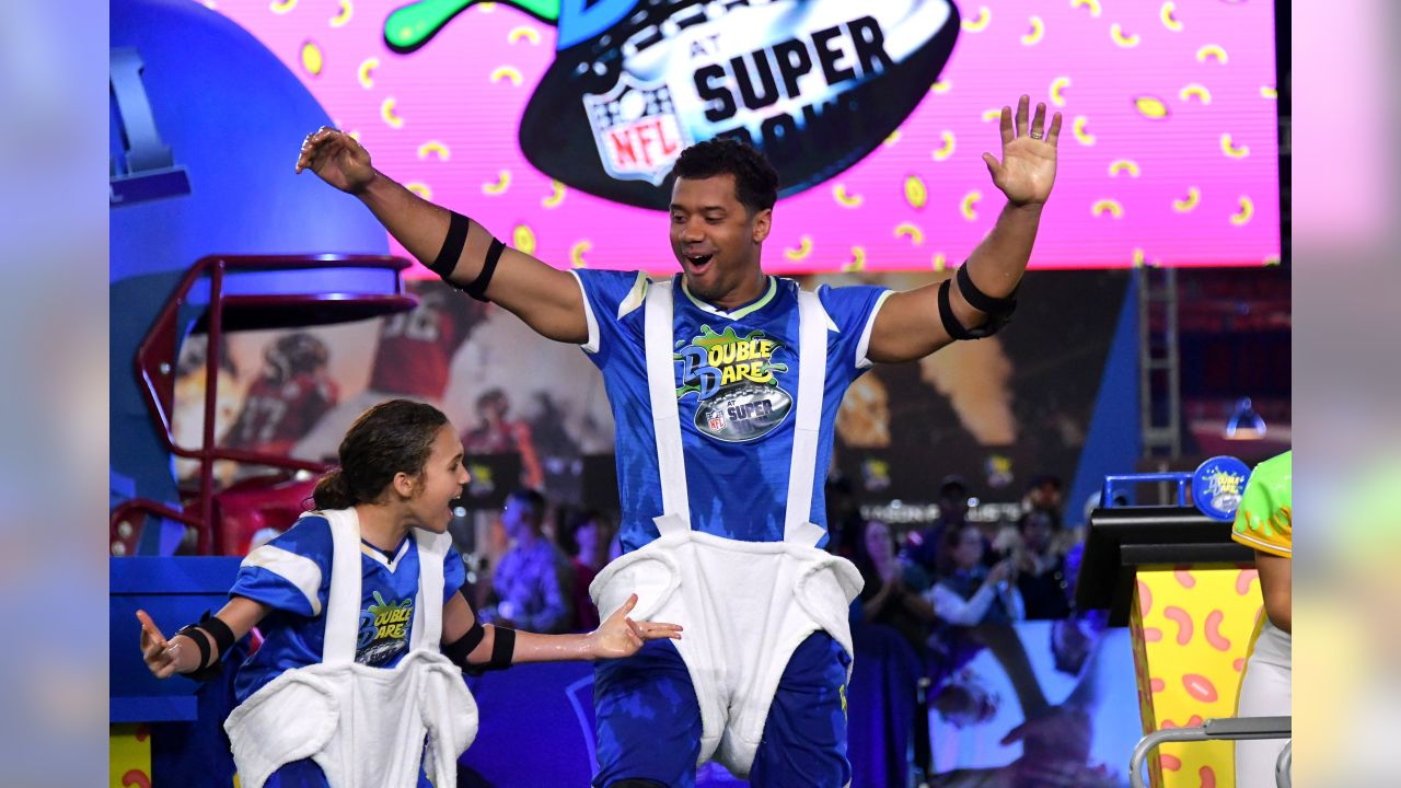 ATLANTA, GEORGIA - JANUARY 31: (L-R) Scarlet Spencer and Russell Wilson compete during Nickelodeon's Double Dare Takes The Gridiron At Super Bowl LIII at Georgia World Congress Center on January 31, 2019 in Atlanta, Georgia. (Photo by Mike Coppola/Getty Images for Nickelodeon )